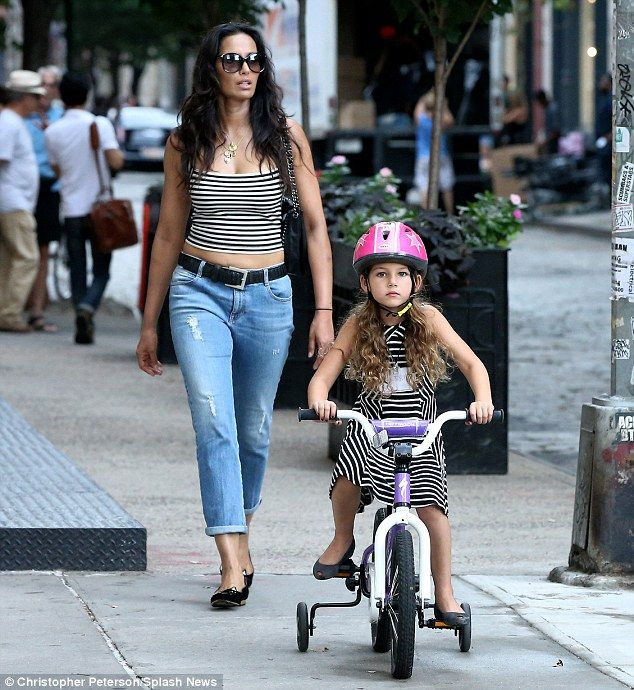 Quality time! Padma Lakshmi kept it casual in a tight tank top and jeans as she followed her daughter Krishna, who rode on her bike, in New York City on Wednesday
