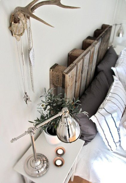 headboard. task lamp. antlers. simple, masculine bedding.