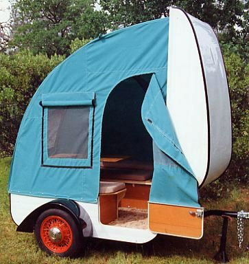 Tiny pop up camper. (= it's the size of a suitcase when folded. ;)
