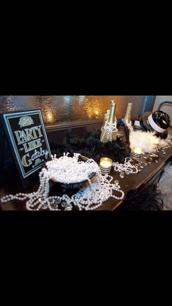 Having a Roaring Twenties themed or Great Gatsby wedding or event?! Want to add some glitz, glamour, but keep it fun and flirty? Then you need a custom created Ostrich Feather Centerpiece! This gorgeous Gold Glittered centerpiece was designed with your occasion in mind. Spice up your wedding or party table décor using this fun Art Deco inspired creation. This Gold Glittered Wine Bottle has been painted all gold & carefully decorated with gold glitter that catches the light wherever its…