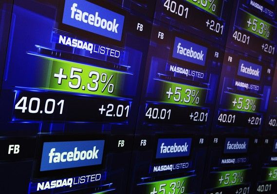 Screens displaying Facebook's share price inside the Nasdaq Marketsite in New York. May 18, 2012.