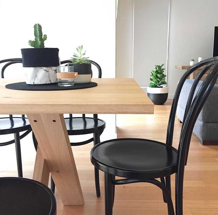 A stunning timber dining table with fabulous black dining chairs. Want and want. Table and chairs by @banyantreefurniture. Photo by @misspotspouches