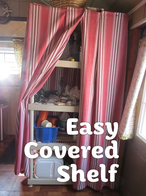 Easy Covered Shelf :: Cover a plastic shelving unit with two large table cloths, for instant hidden storage.