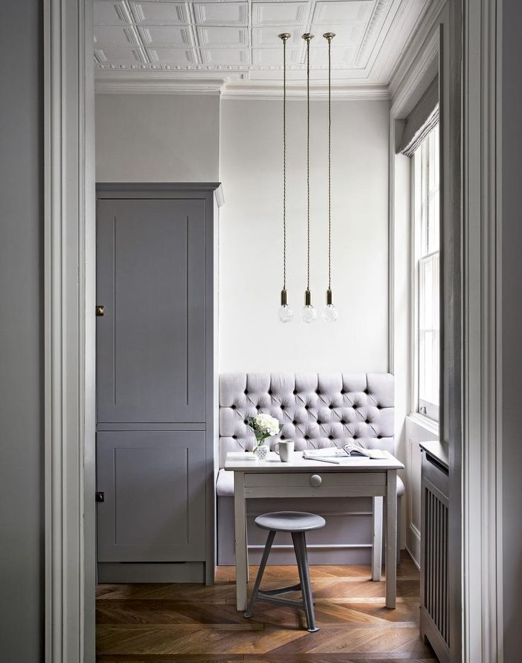 Small Banquette Eataing Area and Trio of Pendant Lights