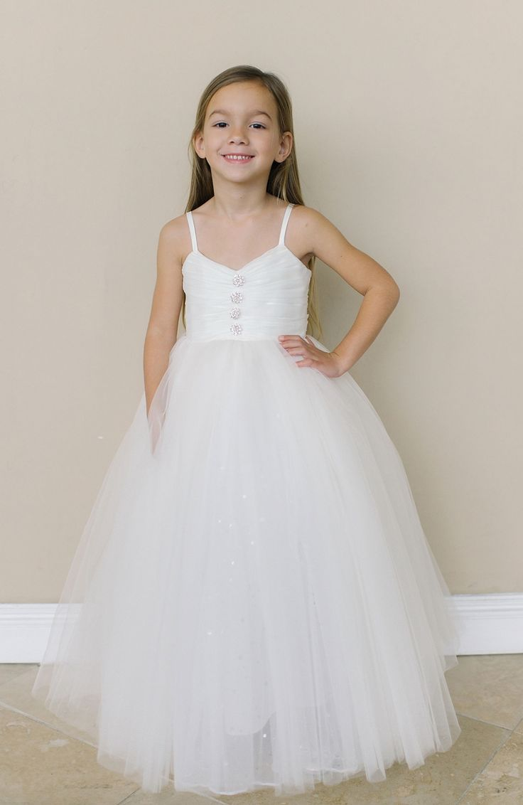 Amalee Couture flower girl and first communion tulle dress gives you a beautiful blend of a classic and modern feel making sweet memories on her special day.