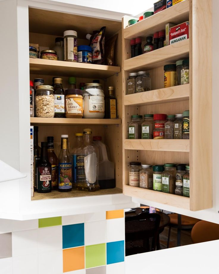 The backside of a kitchen cabinet door is a space with great potential that's too often wasted. A spice rack is an ideal way to put it to use — it frees up the inside of the cabinet and keeps all those tiny bottles neat and readable at eye level. Designer Jan Goldman of Kitchen Elements had this cabinet custom-made for her client, but there are lots of prefab wall-mounted options available designed specifically for spice storage.