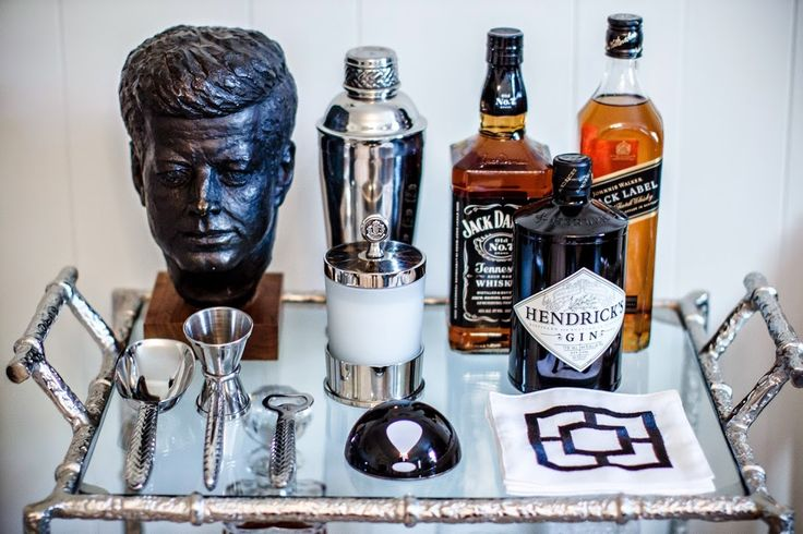 This is the bar cart in my husband's man cave. I think it's masculine but with some fun and whimsical touches like the vintage pair of...