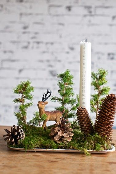 "This type of greenery and pine cones on wooden ""plate"" with a candle and a wooden deer would make a beautiful winter or Christmas display"