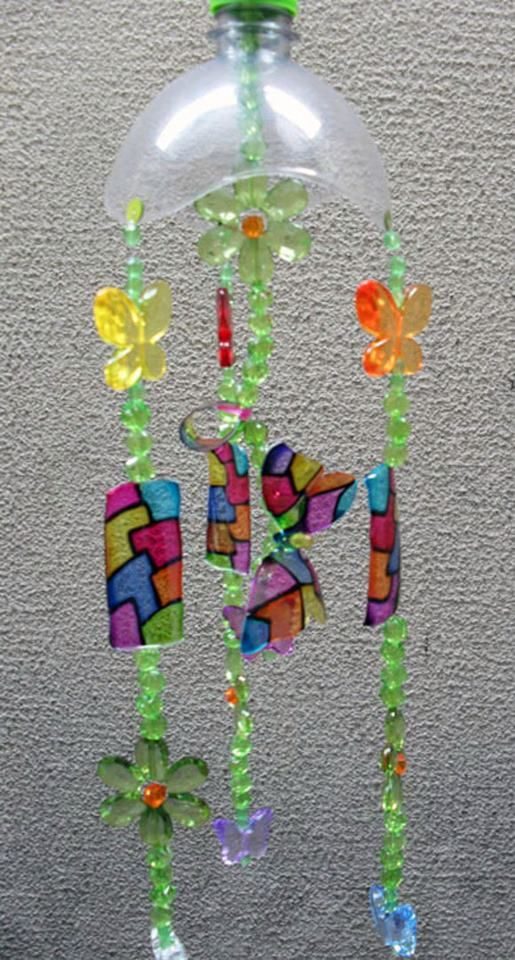 Winds bell made of plastic bottle, decorated with stained glass painting.