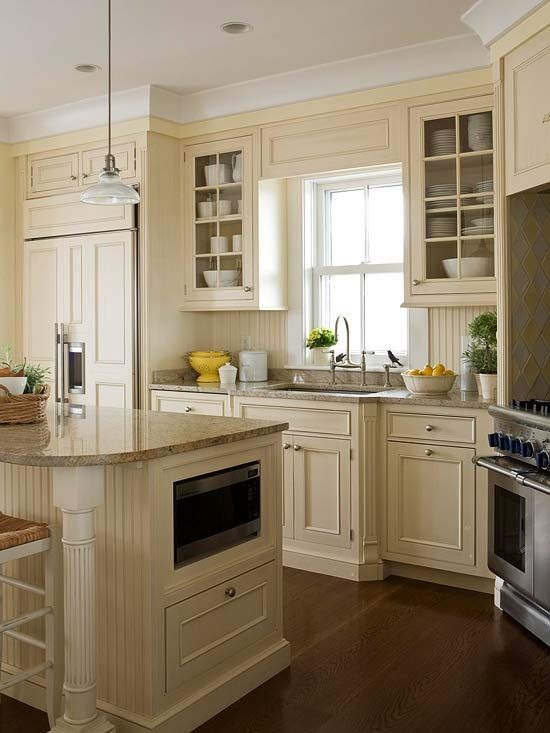 cream kitchen - Microwave built in to lower cabinets