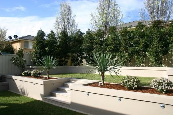 Garden Design Ideas by Jays Landscaping. love the retaining wall
