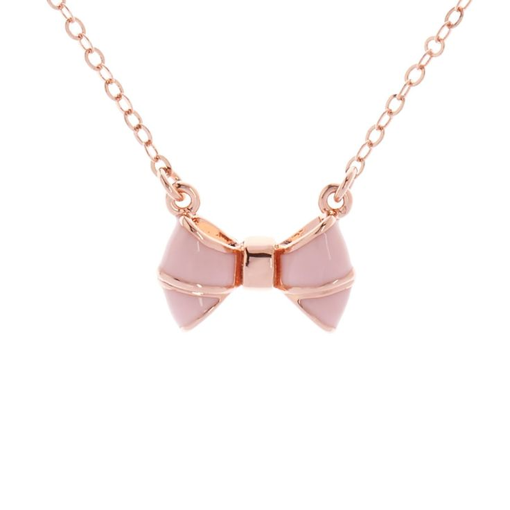 Edda Pink Baby Bow Pendant by Ted Baker. Tiny pink enamel bow pendant with rose gold finish. Presented with Ted Baker gift packaging.