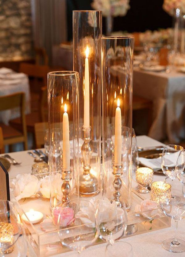 Who Says Your Centerpiece Should Be Flowers These Tall Candles Are A Perfect Examp Candle Wedding Centerpieces Wedding Table Centerpieces Wedding Centerpieces