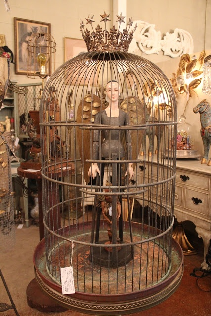 Bird Santos in a  Cage by White Horse Relics