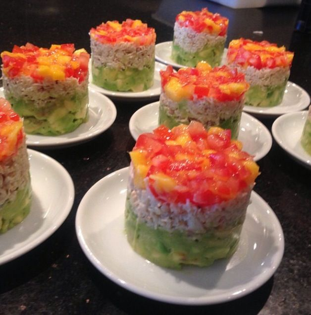Avocado and crab terrine, topped with tomato and mango salsa