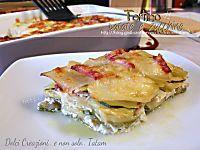 La Parmigiana di patate è unottimosecondo piatto o anche un piatto unico composto da strati di patate alternate da mortadella e formaggi e mozzarella