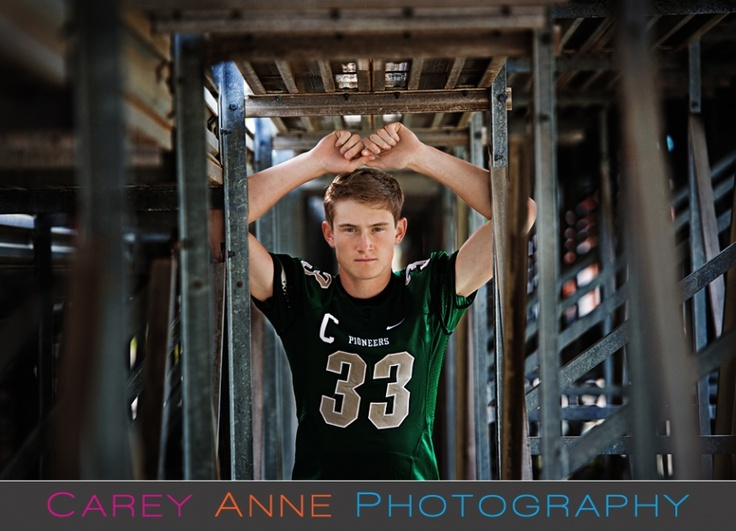senior football pose Carey Anne Photography