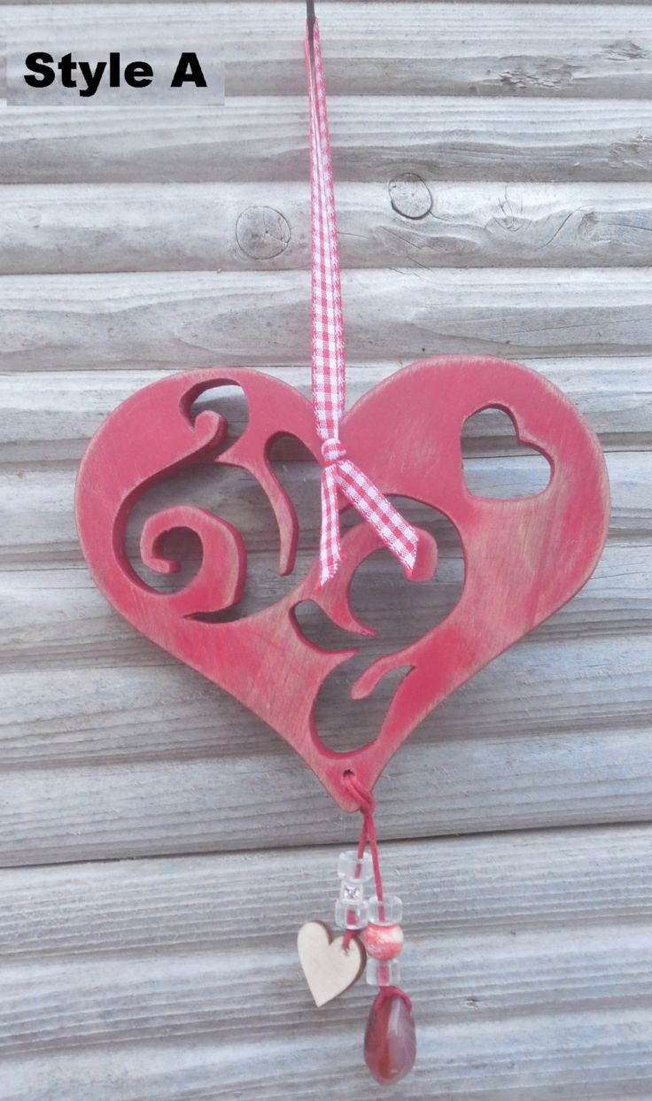 Hanging Wooden tribal - scrolled hearts with beads. by DesertHeartsCo on Etsy
