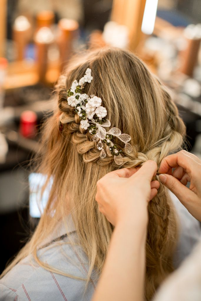 Wedding Day Hairstyles and Inspiration - we love a braid with some floral detail that leaves an elegance wherever you go. Wedding dress and hair accessory by international designer, Pronovias