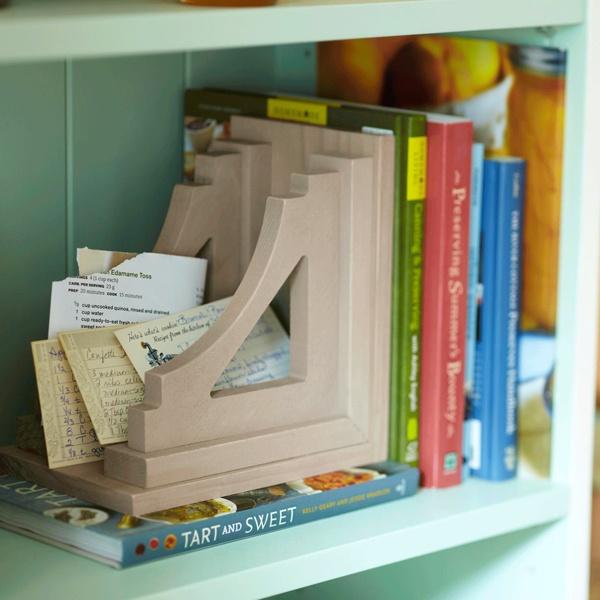 Bookend caddy on bookshelf