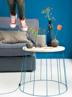 Side table made from a painted lampshade frame. Clever.