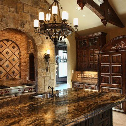 Love the stone countertops and the mix of different stone textures. Colors are great. Would change light fixtures though. (Originally from Broadstone)