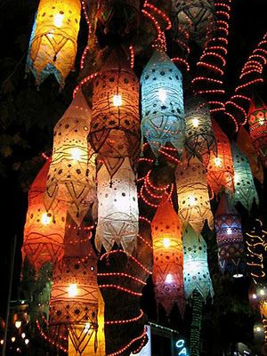 These beautiful paper lanterns can be easily re-created with paperclips, tape, multicolored tissue paper, pens, and sequins. Check Ikea for cheap lamp bulb/cord kits .