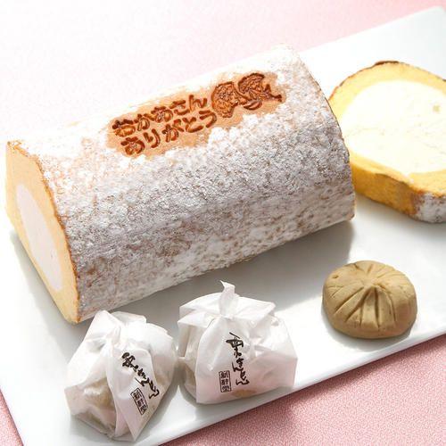 【母の日スーパースターロール】ラム酒がほんのり香るクリームを、ふわふわの生地で一巻きにしました。「おかあさんありがとう」のメッセージ入り。【栗きんとん】国産栗と砂糖のみで仕上げた、岐阜県中津川市の銘菓です。栗の味を存分に味わえる栗菓子です。