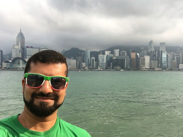 At Tsim Sha Tsui waterfront in Kowloon, with Hong Kong in the background.