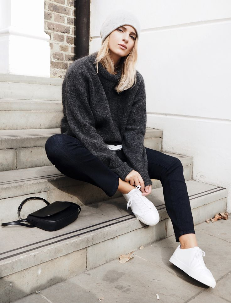 Mirjam Flatau wears a gorgeous knit sweater with black jeans and sneakers. Jumper: Acne Studios, Denim: AYR.
