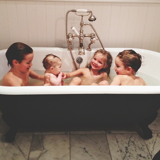 A blurry photo of all four in the bath together for the first time. #theylovedit #iwasanervouswreck