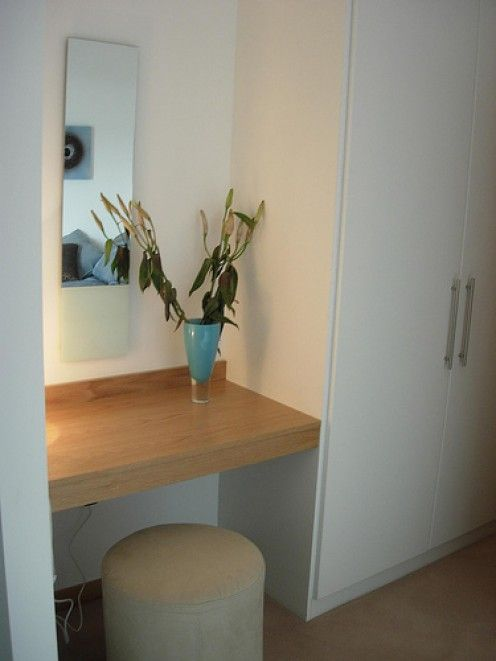 MASTER BEDROOM vanity- dealing with a tiny bathroom & have extra space in the bedroom or hallway? why not install a countertop to use as a vanity area. In this photo, a pre-made section of countertop was positioned between a side wall & closet. To provide maximum support, install using French cleats along the back wall and at least one side. As with most of these ideas, the vanity can also be used as a desk to catch up on personal correspondence.