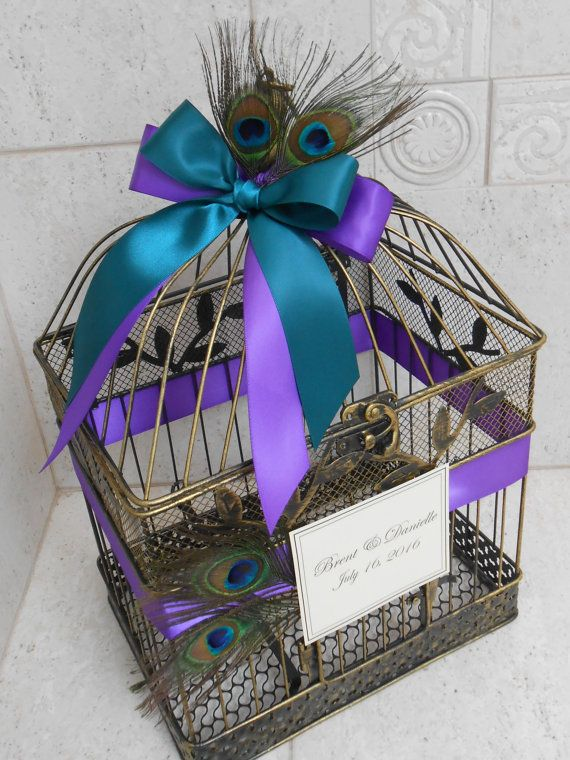 This beautiful peacock birdcage wedding cardholder would be the perfect addition to any peacock themed wedding decor. Comes with your choice of