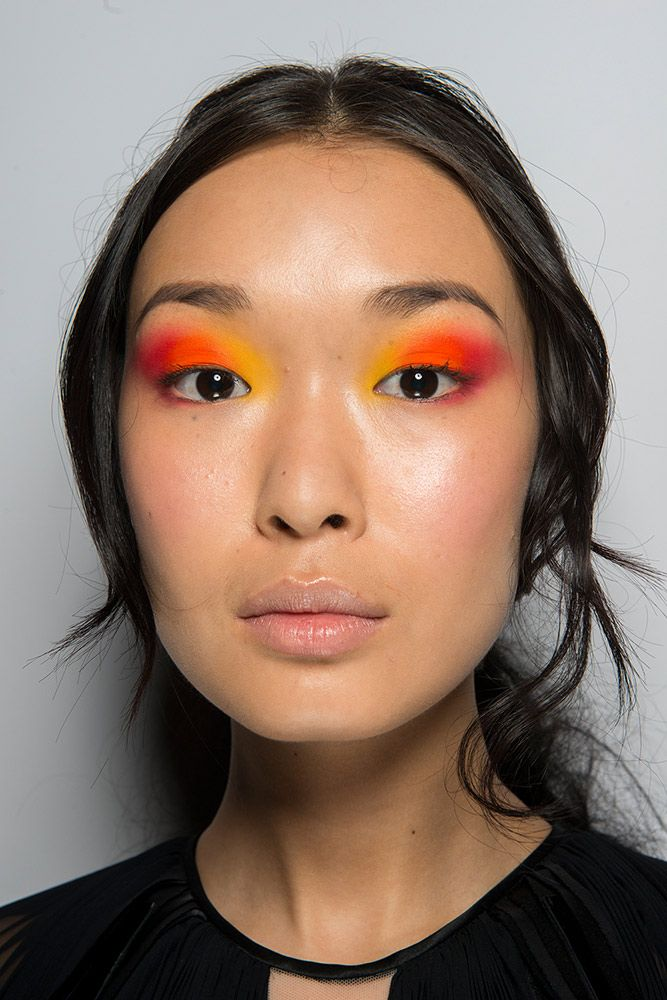 Carmen Marc Valvo combined our love of all things ombre with the bold color trend in this sunset-inspired smoky eye made with opaque matte yellow, orange and red shadows.
