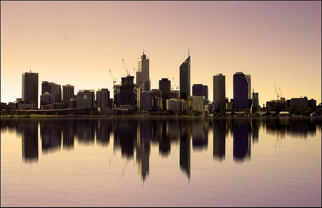 Perth, Western Australia, Australia. A magnificent reflection of the city is cast from the crystal water below.