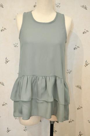 frenda blouse : sleeveless blouse with ruffles IDR 260,000