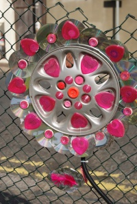 Awesome way to upcycle an old hub cap and some old cd's into a work of art.