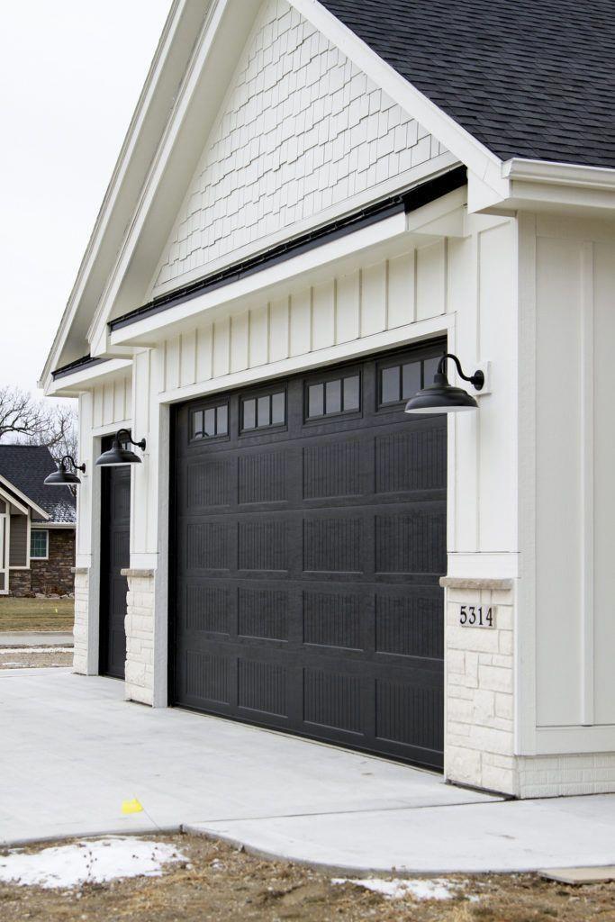 The Chain Drive System Has A Metal Chain Raising The Garage Door Up Or Down Along A Set Of Garage Lights Exterior Garage Door Design Modern Farmhouse Exterior
