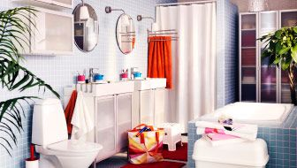 Large IKEA bathroom with two wash-basins, two mirrors and high cabinets