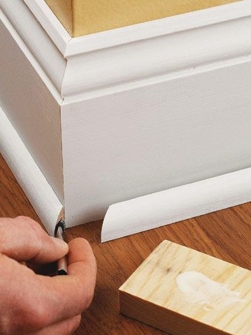 quarter round molding covers gaps between the floor & baseboard