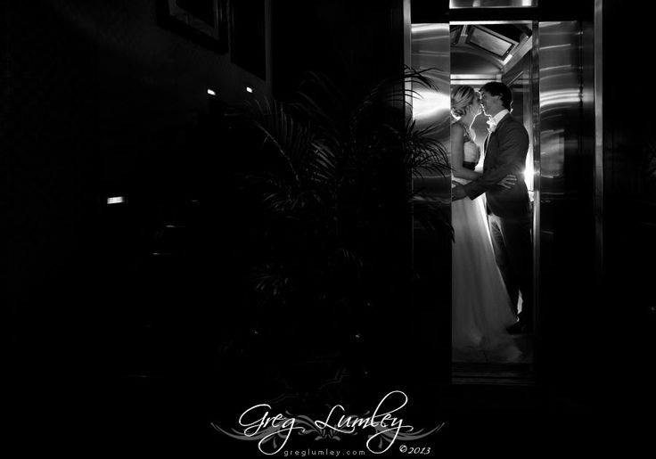 Wedding photos at Twelve apostles cape town.  Photo of bride and groom in lift.  Night photo.