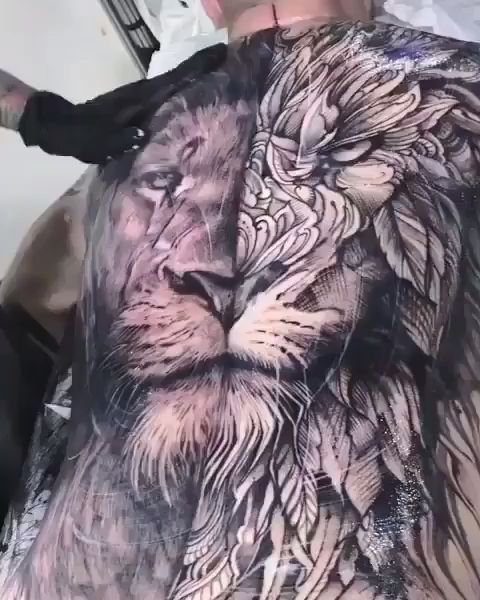Photorealistic And Geometric Lion Back Tattoo By André