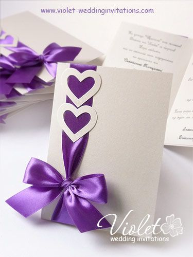 This would look gorgeous with ivory ribbon & hearts to match the outside of the invite.  Easy to do also.