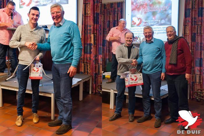 De winnaars van de loterij na afloop van de veiling. / Winners of the lottery of 2 pigeons after the auction.