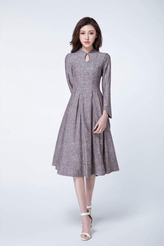 54f86b8a32 The retro dress is made from a lightweight linen fabrication in a fitted  waist construction. The handmade linen dress topped with a fitted waist +  mandarin ...