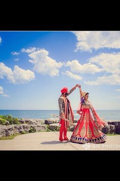 Absolutely in love with this photo! Matching desi dresses for the bride and groom! So cute!