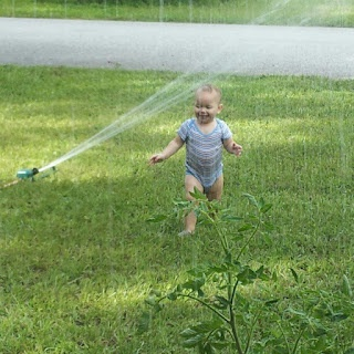 This is one of my favorite summer pictures :) Our baby's 1st sprinkler experience.