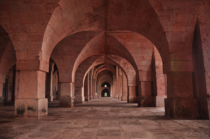 The hugely fanned out arches inside the Grand Jami Masjid