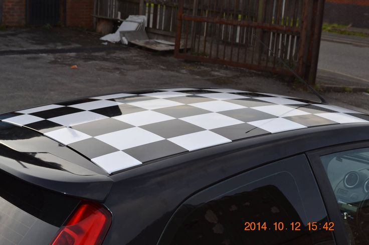 Custom chequerboard roof wrap designed produced and fitted by buzzworx newcastle under car stickerscar