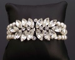 The Lucia Bracelet - €108/$145 http://www.julesbridaljewellery.com/collections/wedding-bracelets/products/luscious-rhinestone-triple-row-pearl-bracelet-lucia